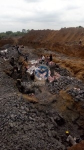 Artisanal miners on the lead/zinc ore vien line at Abuni